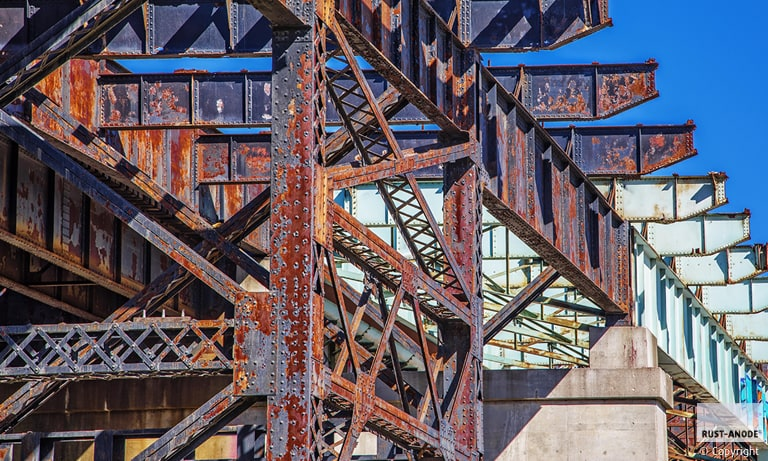 Rust treatment on steel beams and infrastructures